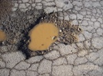A close up of Pot Hole Repair